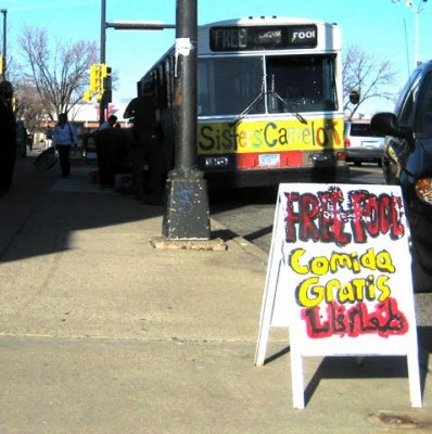 The Sisters' Camelot bus advertises its wares on the corner of Nicollet Avenue and Lake Street.