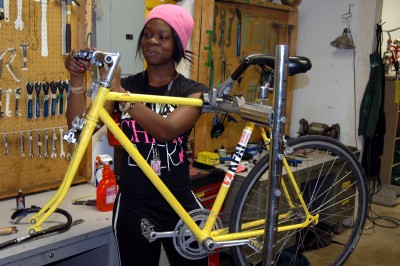 High school senior Laqueshia Moran works on her bikes at the Sibley Bike Depot's Open Shop. Photo by Jake Mohan.